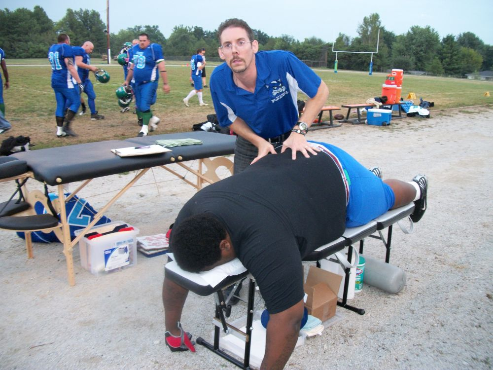 Dr. Austin performing a right sacro-iliac joint (lower back) adjustment on a semi-pro football player.