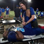 Dr. Todd helps to stretch out a tight hamstring tendon in the early 4th quarter.