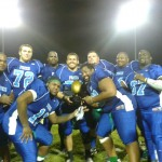 Some proud Foxes hold up the Corn-land Bowl Trophy after beating the Steel!