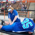 Eugena performing a hamstring muscle massage