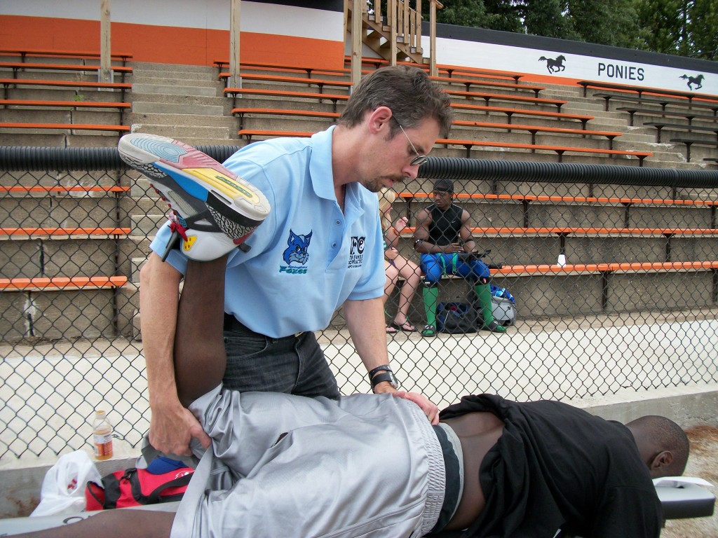 Dr. Todd performing a low back exam prior to game time.