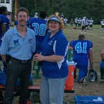 Dr. Todd & Eugena Austin catch a chance to relax on the Foxes sideline.