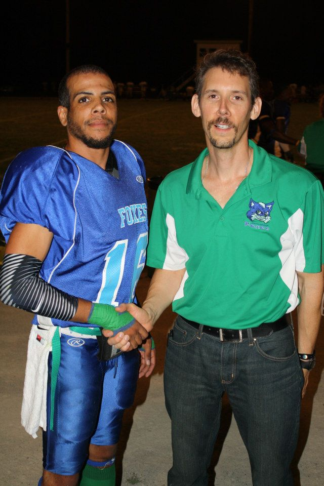 "Team Chiropractor Todd Austin (right) with one of the games co-MVPs on defense.  After helping out #16 Lance Still with an advanced hamstring taping technique, Still had 2 ""picks"" and over 125 return yards on the night."
