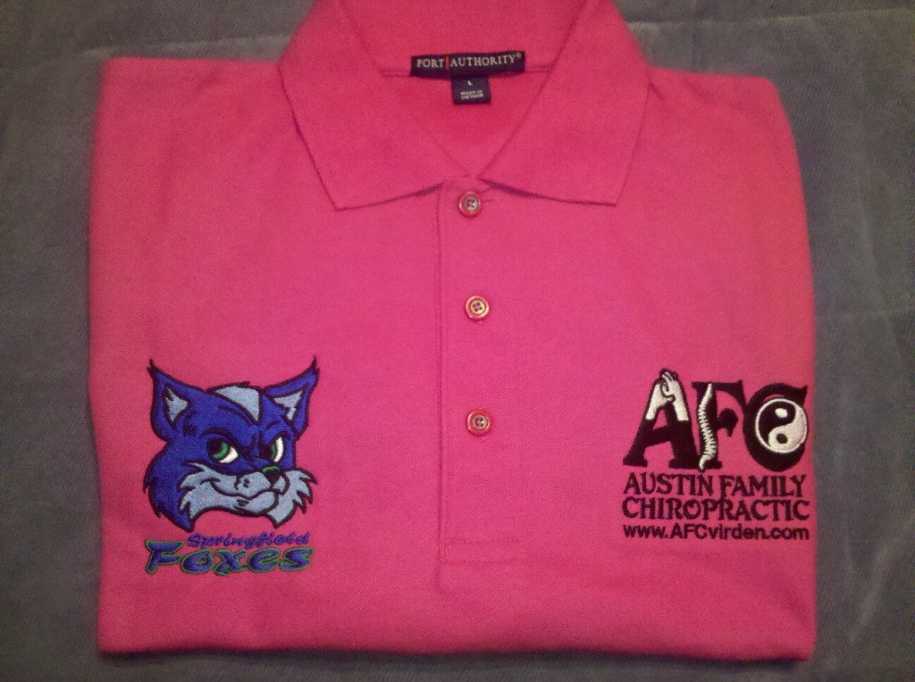 The Springfield Foxes / Austin Family Chiropractic pink 'Breast Cancer Awareness' polos for 2012.